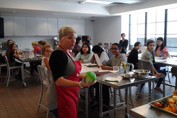 Culinary literacy partner Shayna Marmar addresses the class