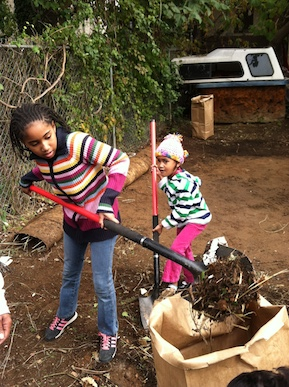 Young Fairhill residents clean a blighted lot near their home