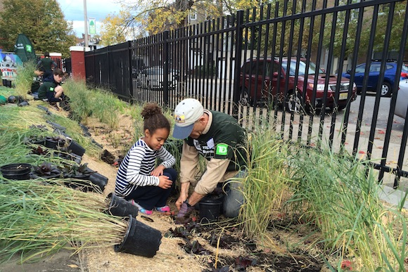 Volunteers planting at Lea Elementary