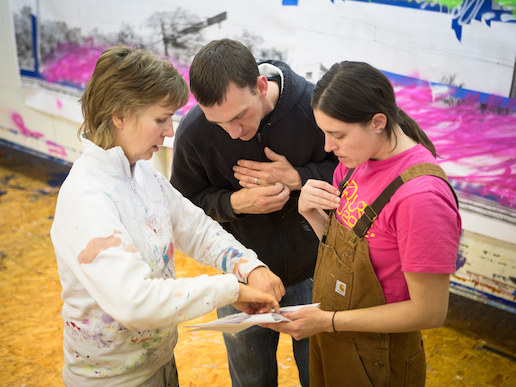 Artist Katharina Grosse instructs her assistants