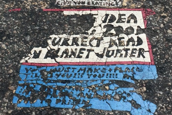 A fading Toynbee Tile at 34th and Chestnut